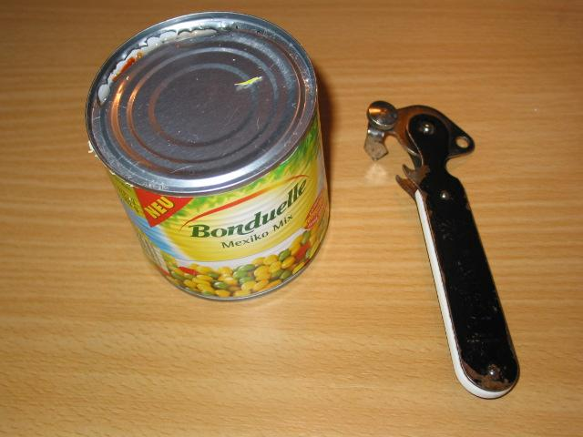 Trying to open a can of vegetables
