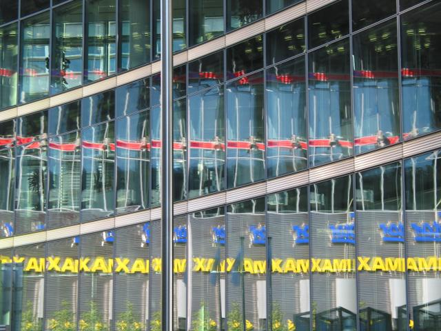 Berlin Potsdamer Platz: Reflections of two signs in many windows