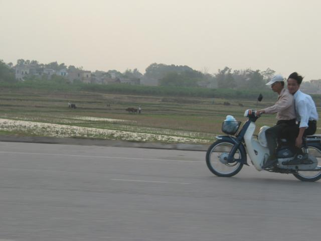 Motorbike riders on expressway from Hanoi airport