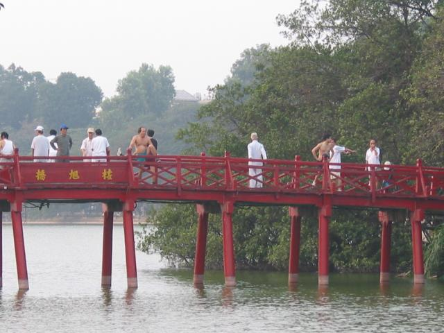 Morning tai chi on The Huc (Rising Sun) bridge