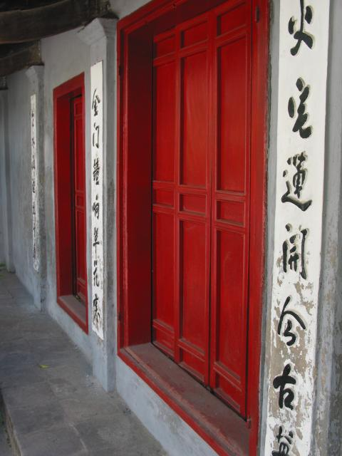 Closed doors and inscriptions on wall at Ngoc Son temple