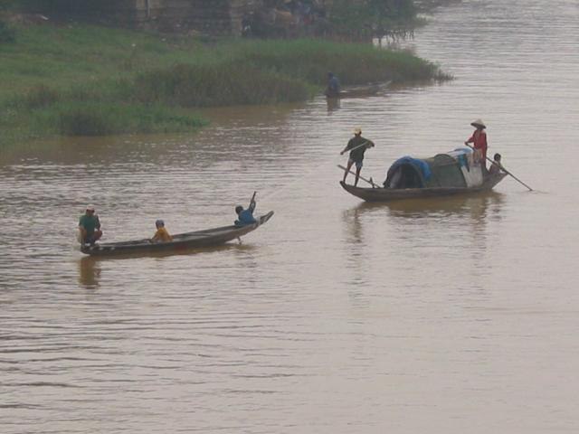 Two family fishing boats on the Perfume River