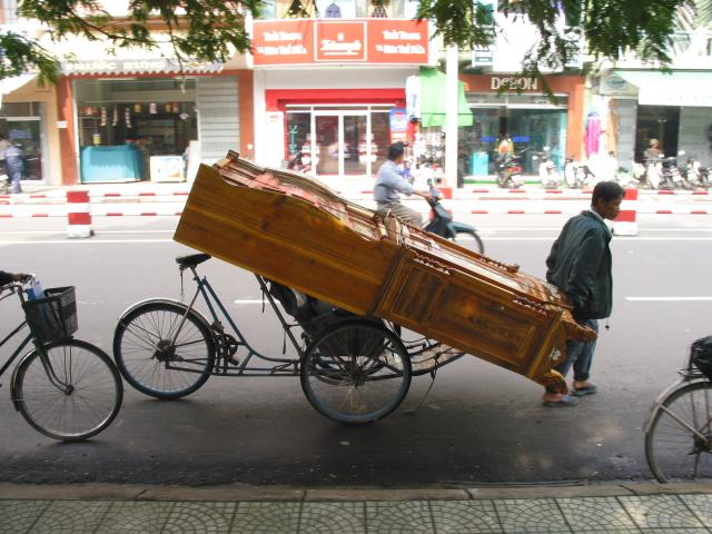 Hauling a cabinet on a cyclo