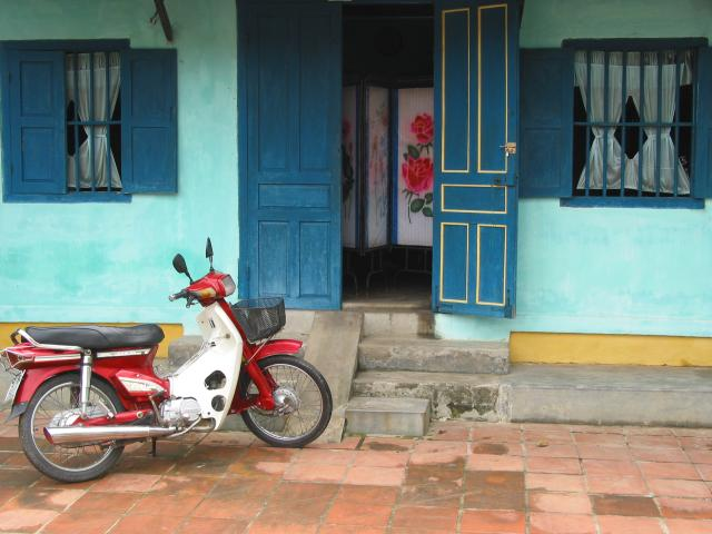 House with screen inside and motorbike outside