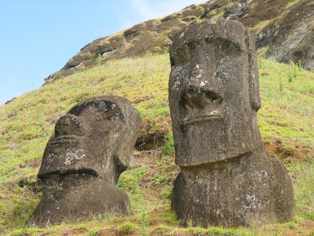 Two moai, one on its back and one facing forward