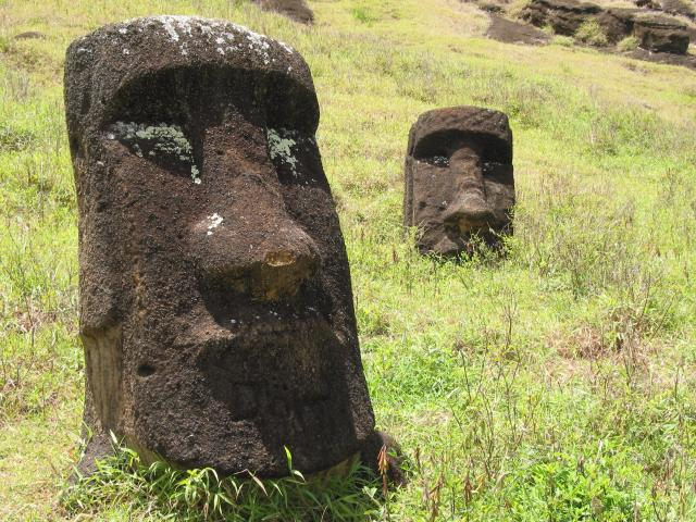 Large moai face at left, more-distant face at middle