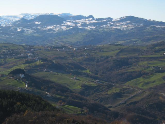 View from San Marino toward hills and snowy peaks