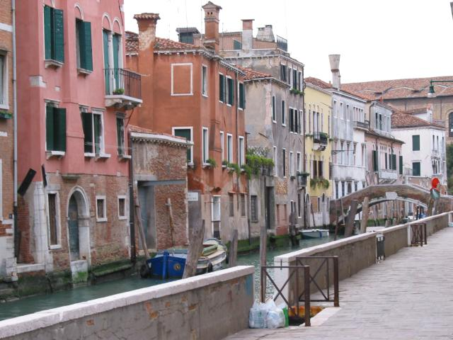 Brightly-colored buildings behind a small canal