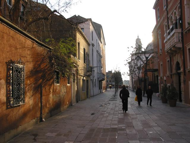 Late-afternoon view of people walking along a street, Venezia