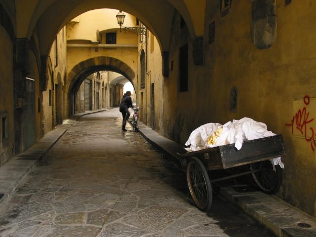 small street with cart and man with bicycle, Firenze