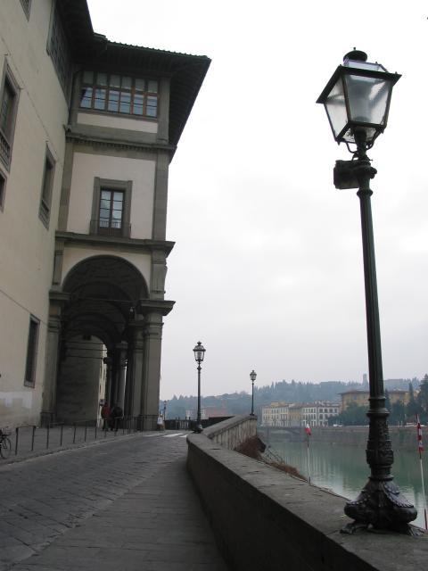 Street lamps, street and building along the Arno, Firenze