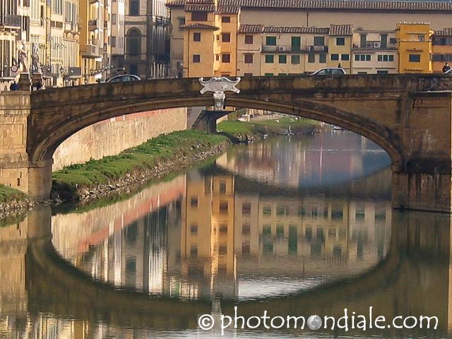 Bridge over the Arno with buildings reflected under its arch, Firenze