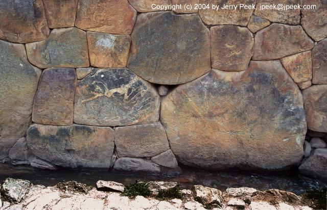 Bottom of stone wall and water channel, Ollantaytambo, Peru