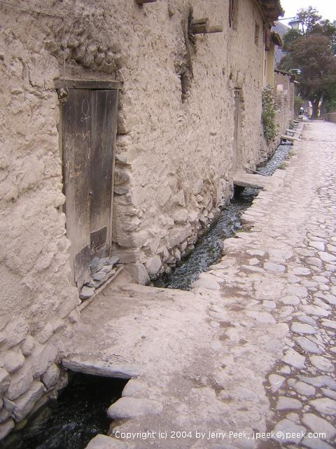 Bridges to building entrances over water channels, Ollantaytambo, Peru