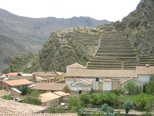 Temple and other ruins with modern buildings in front, Ollantaytambo, Peru
