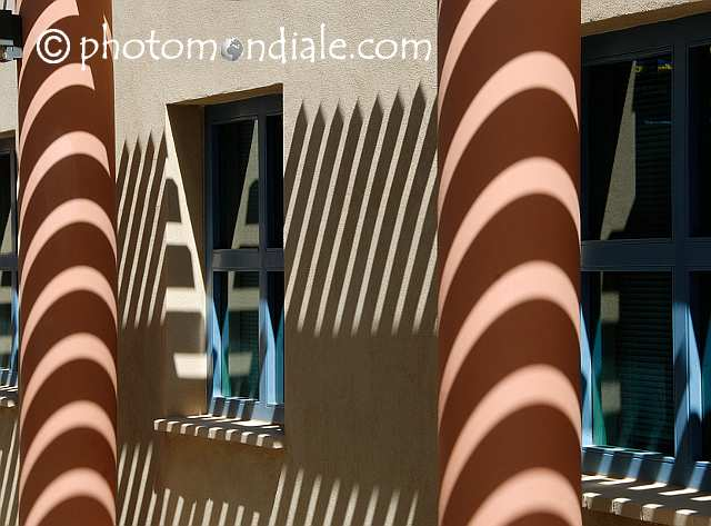 Sun and shadow on the wall of the entryway at Indian Oasis Intermediate School in Sells, AZ