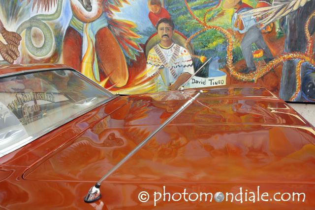 Red low-rider Chevy and David Tineo mural, Tucson Museum of Art plaza