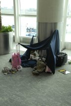 Tent made from airline blankets for children spending the night on the floor of Guayaquil Airport