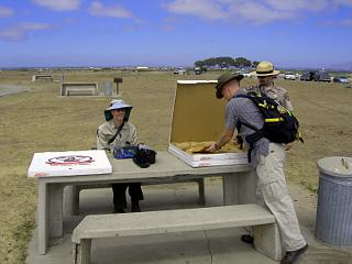 California State Park Rangers with pizza for beach cleanup volunteers