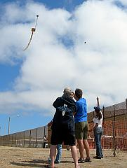 Flying kites from the US side of the border fence