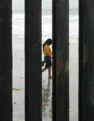 Mexican Scout through the border fence