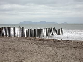 Border fence extending into Pacific Ocean at Imperial Beach, California